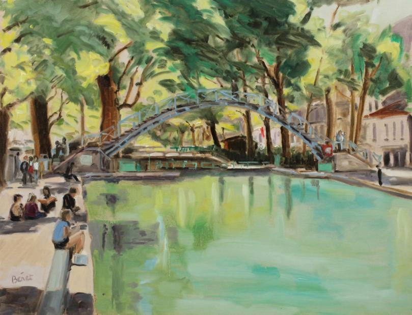Journée d'été le long du canal Saint Martin, la lumière des feuillages colore l'eau
